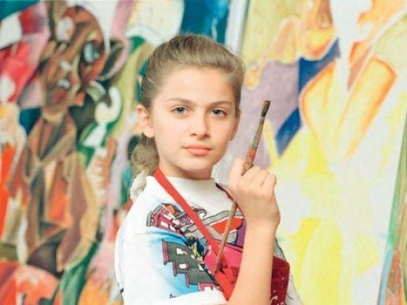 Îţi mai aminteşti de micuţa Picasso? Alexandra Nechita are acum 31 de ani şi e mămică! Cât de frumoasă e fiica ei