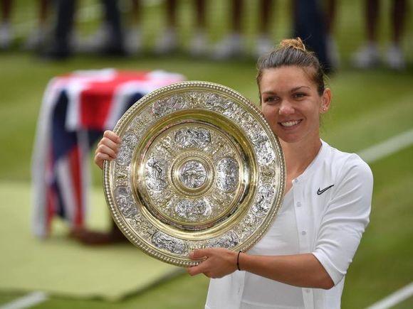 Simona Halep îi plăteşte un impozit uriaş Reginei Angliei! Vezi câţi bani i se vor reţine Simonei din premiul de 2,35 milioane de lire sterline de la Wimbledon!