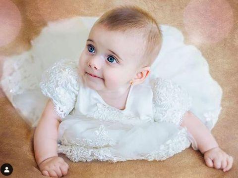 Am aflat adevărul! De ce s-a îmbrăcat Gabriela Cristea în rochie de mireasă la botezul fetiței sale!