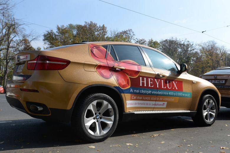 BMW-urile aurii de la Heylux promovează cel mai bun studio de videochat din Iaşi