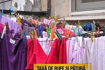 Rufele de la balcoane, preocuparea principala a edililor din Timisoara! Amenda de 1000 de lei pentru cine scutura covoarele si paturile pe geam VIDEO