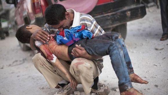 MASACRU in Siria! Peste 100 de oameni, inclusivi femei si copii, au fost UCISI cu sange rece