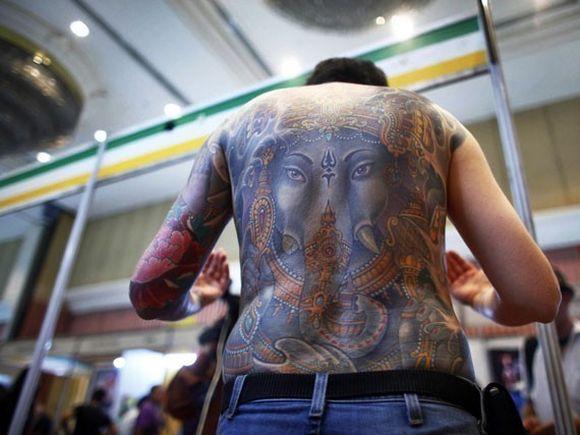 ARTA sau PROST GUST? 25 de oameni care au ales sa fie purtatorii unor TATUAJE EXTREME FOTO