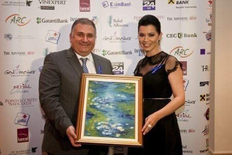 Tabloul Lac cu nufer semnat de Simona Patruleasa a fost licitat cu 2100 lei la Balul Albastru