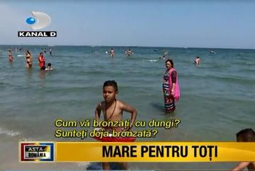 Este loc sub soare pentru toti! Litoralul romanesc a fost luat cu asalt si anul acesta de sute de turisti de diverse categorii