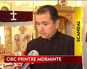 STIREA ZILEI: Circ printre morminte: Fostul preot al unui sat din Ialomita s-a luat la bataie cu primarul! VIDEO