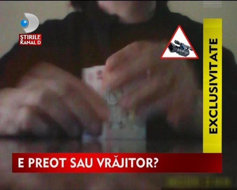 Un preot din Maramures se bate cu vrajitoarele pentru clienti VIDEO
