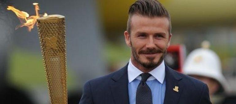 David Beckham a adus flacara olimpica in Marea Britanie