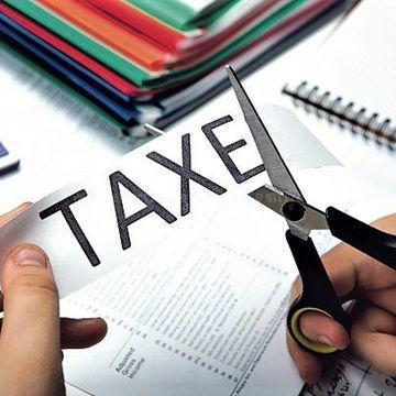 Iohannis a semnat! Cine sunt romanii care nu mai platesc impozite
