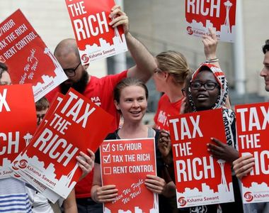 Cei mai bogaţi oameni ai lumii cer să fie taxaţi mai mult