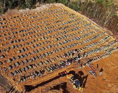 Imagini devastatoare cu sute de morminte ale pacienților coronavirus. Sunt peste două...
