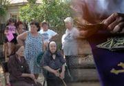 """VIDEO - Revolta credincioșilor într-un sat din Giurgiu: """"Părinte, nu vă mai vrea nimeni!"""""""