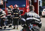 Incendiu puternic la parterul unui bloc. Zeci de persoane au fost evacuate