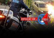 VIDEO - La un pas de moarte. Polițist pe motocicletă, lovit intenționat de o șoferiță