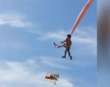 Momentul terifiant în care o fetiță de 3 ani este ridicată 10 metri în aer de un zmeu -...