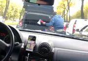 Un șofer din București a scos din portbagaj un topor și a amenințat un alt participant la trafic
