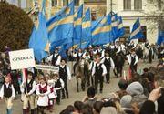 Promovarea șovinismului maghiar. Angajații unui hipermarket din România poartă măști cu steagul secuiesc