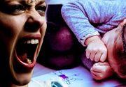 VIDEO - Mama monstru a fost luată de polițiști, copila e traumatizată