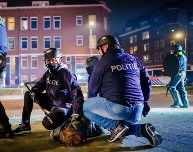 A treia noapte de violenţe în Olanda - Forţele de ordine au făcut mai mult de 150 de...