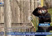 VIDEO - Copil strivit de un gard, la meciul de fotbal