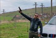 """Poliția îl caută pe individul care trage cu pistolul lângă un BMW """"pentru dușmani"""""""