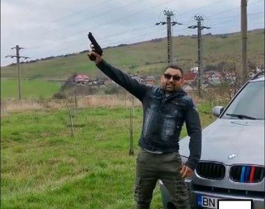 """Poliția îl caută pe individul care trage cu pistolul lângă un BMW """"pentru..."""