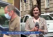 VIDEO - Nouă polițiști acuzați de luare de mită au fost reținuți de anchetatori
