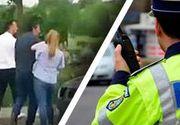 VIDEO - Bătaie în trafic, chiar sub ochii polițiștilor de la Rutieră