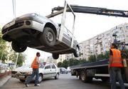 Masinile parcate neregulamentar pot fi ridicate, din nou! Vezi noile reguli stabilite de Guvern