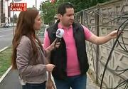 Amenajarea romaneasca! Cablurile de telefonie si internet au fost legate de... garduri! Se intampla in Timisoara!