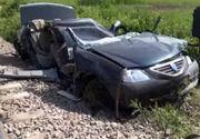 Accident mortal pe calea ferata. Doi barbati au murit dupa ce masina in care se aflau a fost spulberata de tren