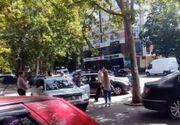 A lovit o femeie pe trotuar, apoi a sarit la bataie, cand oamenii i-au luat apararea victimei
