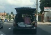 O femeie din Tuzla, plimbata in... portbagaj. In loc sa fie speriata, doamna se distraza de mama focului
