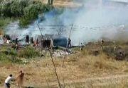 Scandal monstru in Galati. Un barbat a incendiat casa rivalului si a iesit gol pusca pe strada. O femeie ar fi aprins scandalul