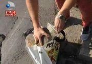 A umplut sacosa cu bucati de asfalt din groapa de pe podul Grant si s-a dus la Administratia Strazilor din Bucuresti! Cum a reactionat directorul cand a vazut pietrele