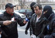 Hackerul Guccifer a fost adus din SUA în România şi încarcerat la Rahova