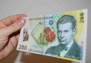 Presedintele Klaus Iohannis a promulgat legea cashback. De la anul, clientii pot primi numerar pana la 200 lei