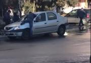 Scandal in plina strada la Constanta. Un barbat sare pe capota unei masini si vrea sa isi bata fosta nevasta - Cum s-a terminat totul