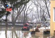 Zeci de case inghitite de ape in Suceava, dupa ce zapada s-a topit. S-a folosit explozibil pentru distrugerea dopurilor de gheata