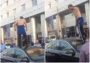 Scandal in Capitala, ziua in amiaza mare! Un barbat a fost filmat cand sare pe plafonul unei masini
