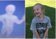 Un copil cu sindrom Down si-ar fi fotografiat ingerul pazitor. Mama copilului e convinsa ca aceasta fiinta i-a aparat in timpul unui zbor cu dificil