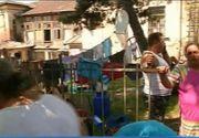 Evacuare cu scandal si plansete, in Iasi, unde mai multe familii au fost scoase in strada dintr-o cladire istorica. Ce au gasit autoritatile inauntru