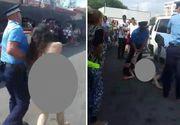 """Scene socante la Targu Jiu. O tanara complet dezbracata a fost tarata pe strada de politisti sub privirile ingrozite ale trecatorilor. """"Nu mai pot!"""", urla fata"""