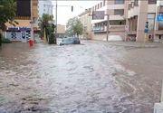 Potop la Tulcea. Masini inghitite de ape, dupa o ploaie torentiala