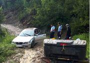 O masina in care se afla un copil de 5 luni, la un pas sa ajunga intr-un parau din Muntii Buzau