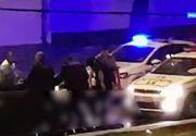 Bataie pe o strada din Bucuresti! Politisti si jandarmi filmati in timp ce calca in picioare un sofer baut