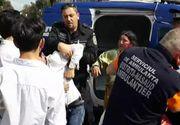 Imagini halucinante la Bistrita! Un politist, atacat de doua clanuri rivale, inarmate cu sabii topoare si o secure