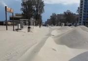 Fenomen rar surprins la Constanta! Dunele de nisip au acoperit promenada din Mamaia