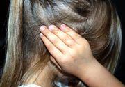 Un barbat din Galati a ajuns in arest dupa ce si-a batut fetita de 7 ani cu coada toporului!
