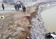 Un copil de 13 ani a murit inecat dupa ce masina in care se afla a plonjat in raul Arges. Tatal sau era la volan!